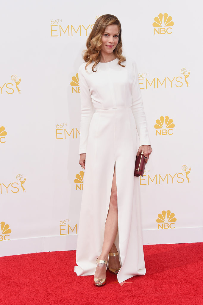 Michelle Monaghan rocked a long-sleeved white Giambattista Valli Fall 2014 Couture gown that has a front-split. She styled her look with gold Christian Louboutin 'Just On' sandals a along with a a metallic M2Malletier clutch and jewelry by Irene Neuwirth .