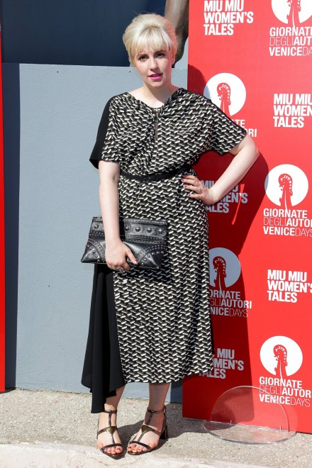 Lena Dunham wore a black and white short sleeve Prada Dress along with bangs and a semi beehive