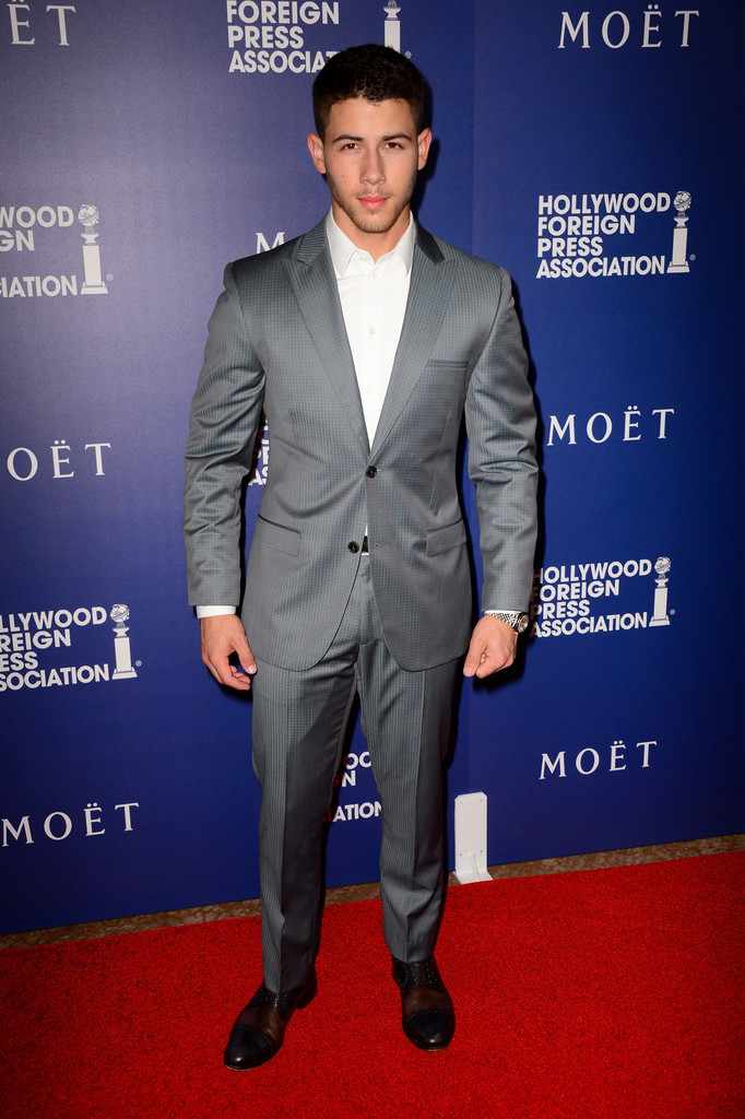 Nick Jonas rocked a gray two-button suit with pleated trousers.
