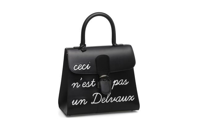 Delvaux Brillant MM plain black leather handbag.