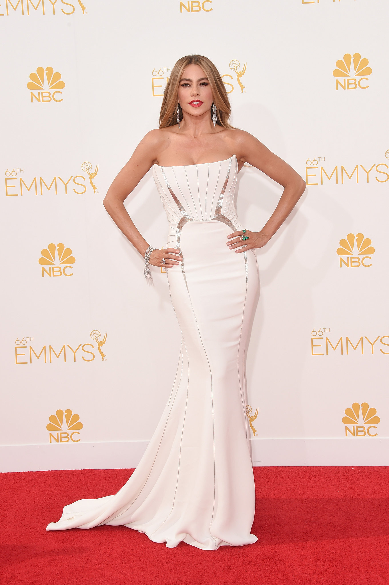 Sofia Vergara in a white strapless Roberto Cavalli gown and Lorraine Schwartz Jewellery at the 2014 Emmy Awards