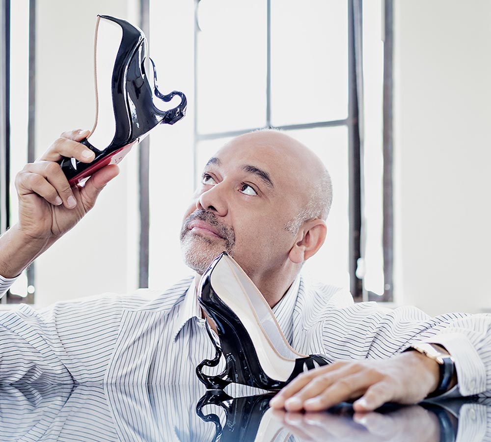 Designer Christian Louboutin admires the shoe. Picture courtesy of Christian Louboutin.