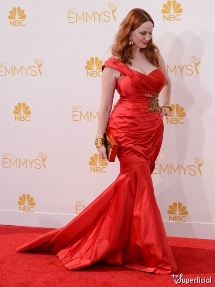 Christina Hendricks in a crimson satin one-shoulder Marchesa gown with crystal embroidery.