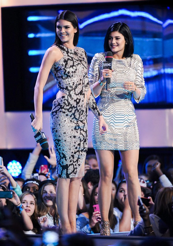 Kendall rocks a iridescent sequinned suit by Perth label, Zhivago and Kylie wore Alex Perry