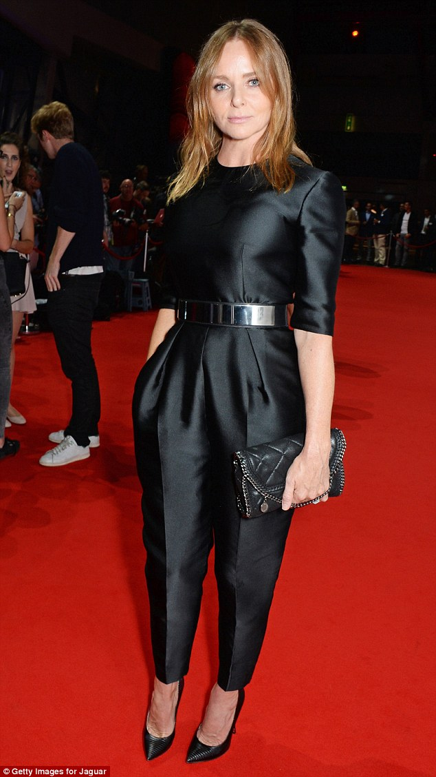 Stella McCartney in a black belted jumpsuit with a black clutch at the Jacquar XE launch party
