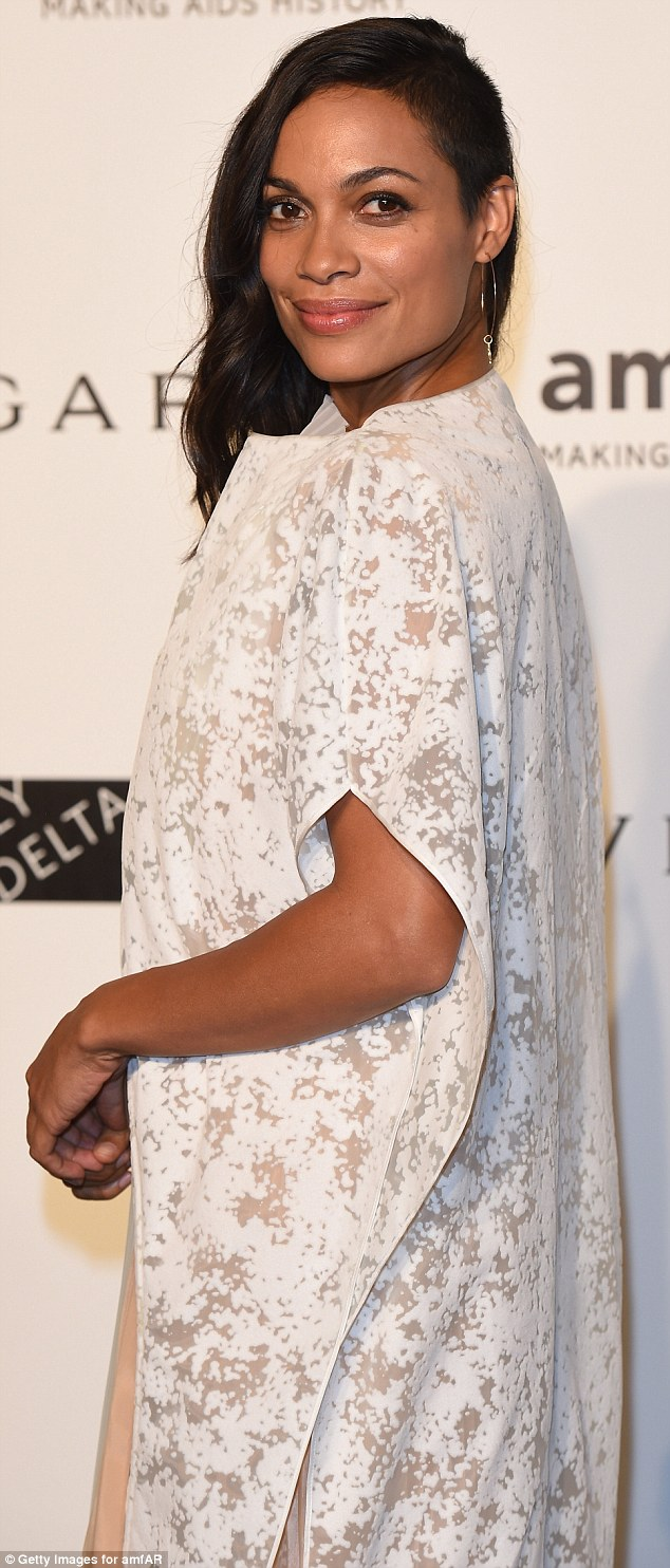 Rosario-Dawson-stands-eclectic-lacy-white-gown-attends-amfAR-Gala.html