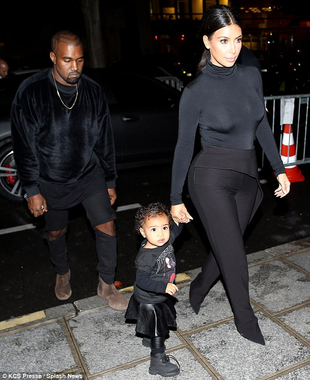 Kanye, Kim & North arriving at the Balenciaga show in Paris