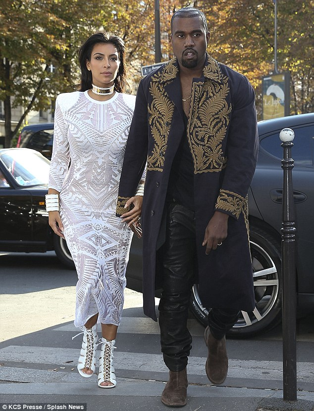 1411727738901_Image_galleryImage_Kanye_West_and_Kim_Kardas
