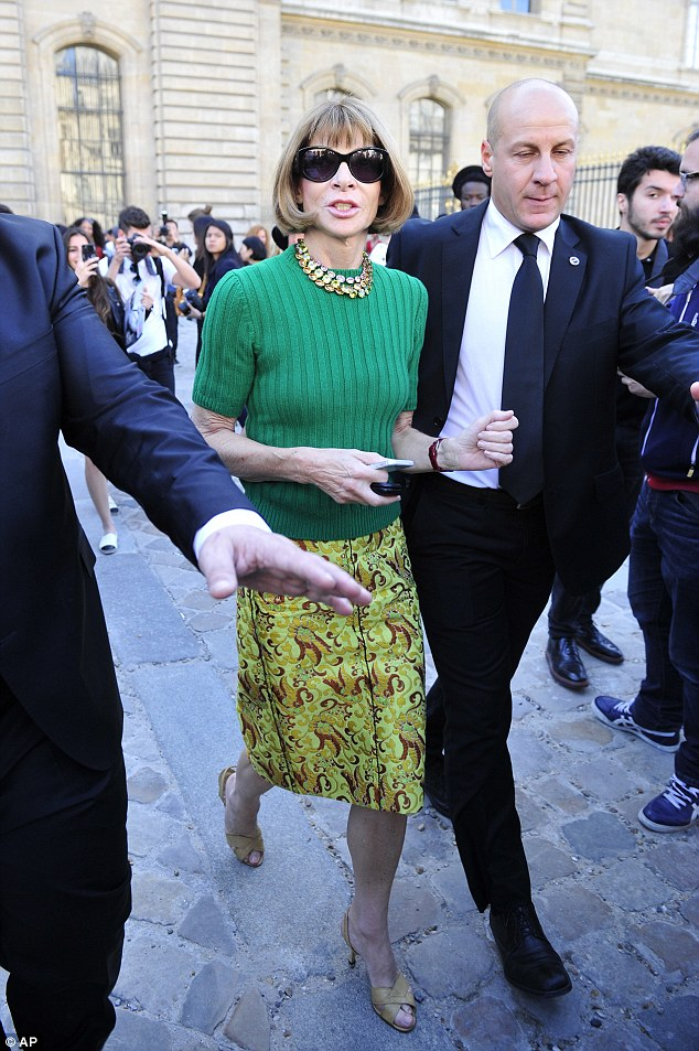 Vogue Chief Editor Anna Wyntour arrival at the Christian Dior Spring 2015 Show in a green sweater and a printed skirt