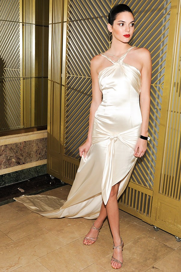 Kendall Jenner in a ivory satin Octavio Carlin gown