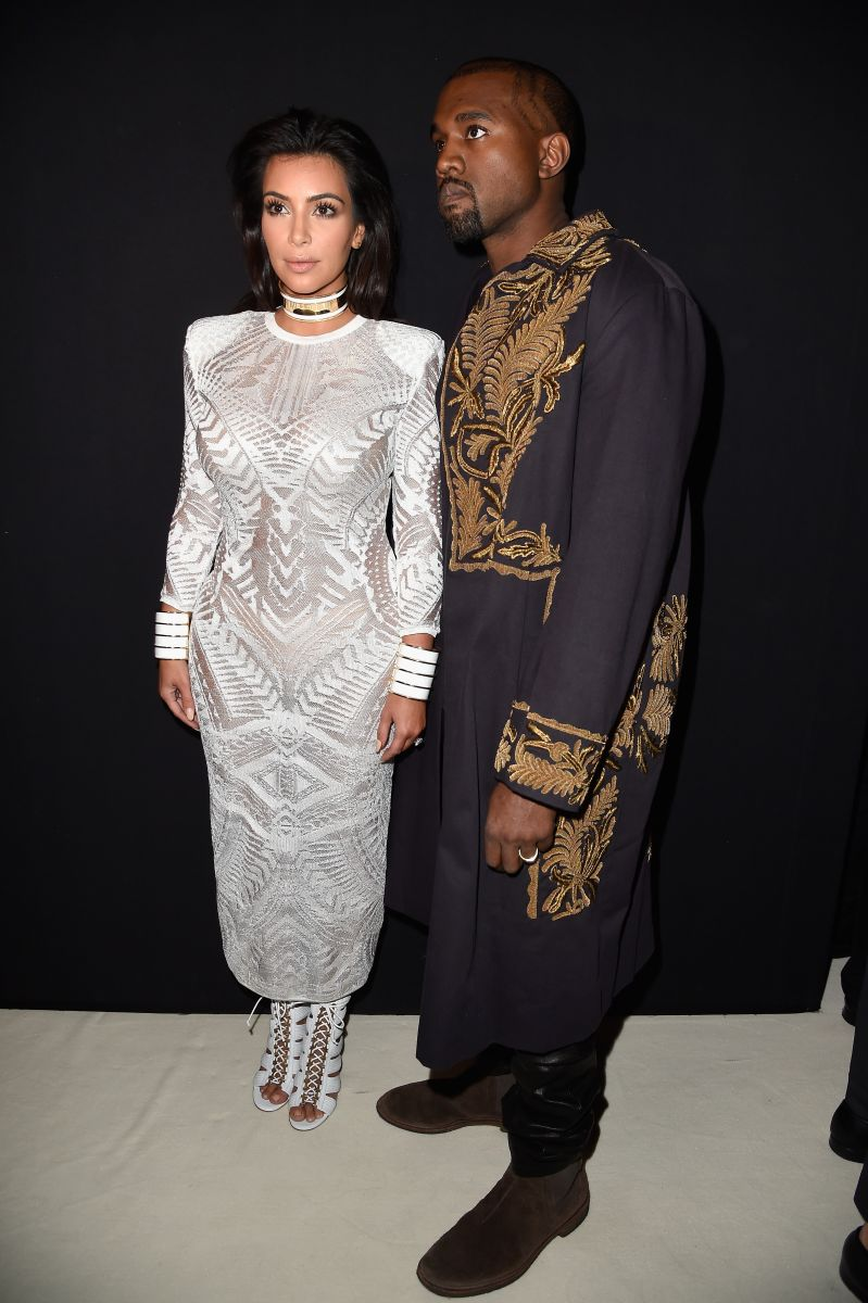 kanye-west-wears-dries-van-noten-golden-embroidered-long-coat-to-balmain-spring-summer-2015