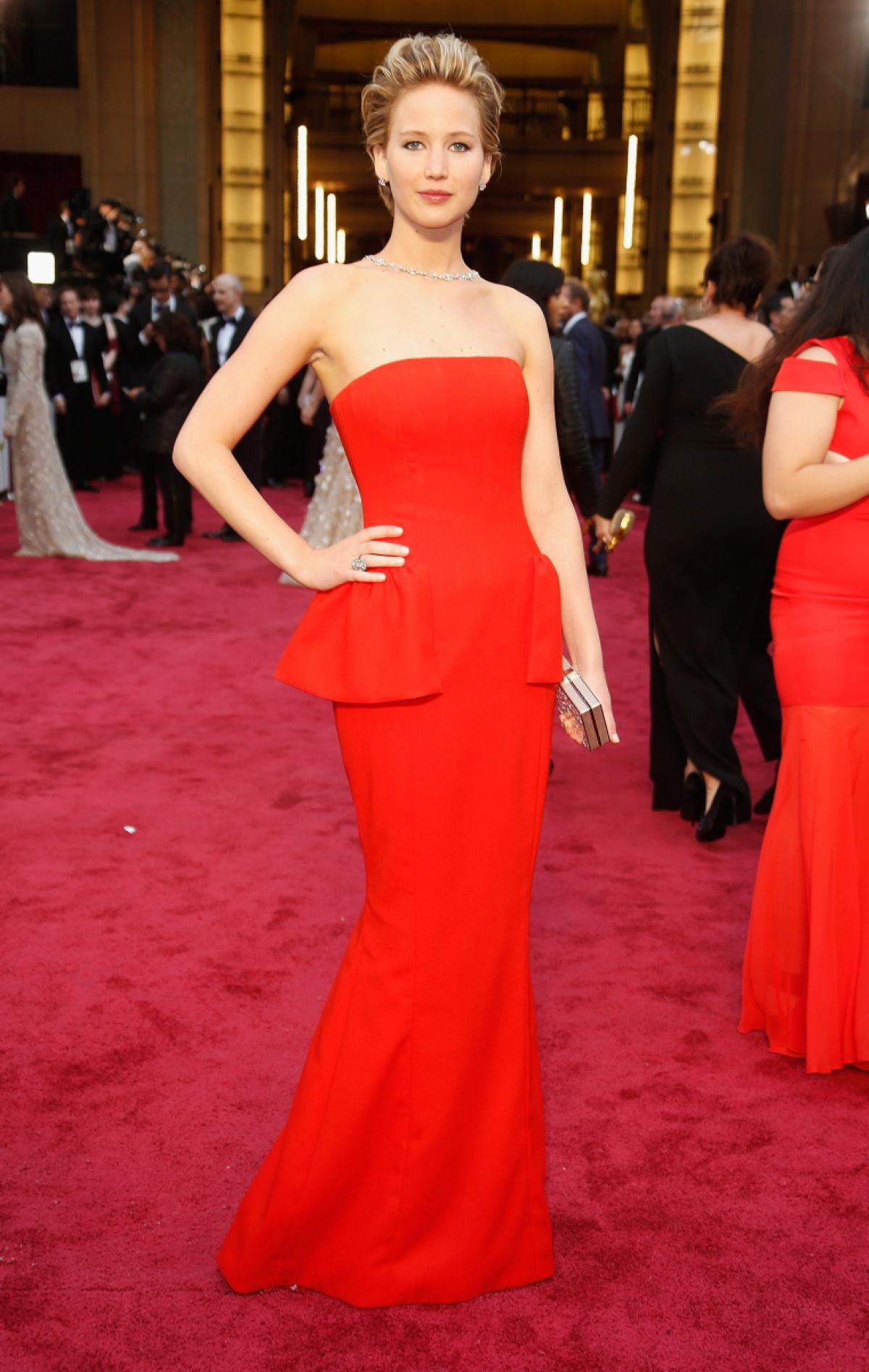 In a strapless peplum Dior gown at The Academy Awards 2014