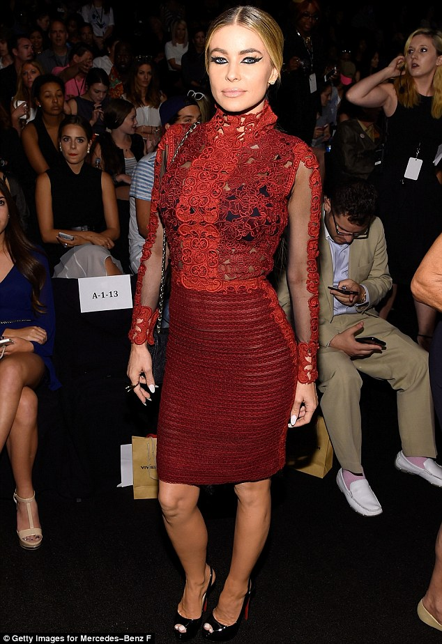 Carmen Electra in a h red lace dress as she attended the Vivienne Tam fashion show during New York Fashion Week on Sunday