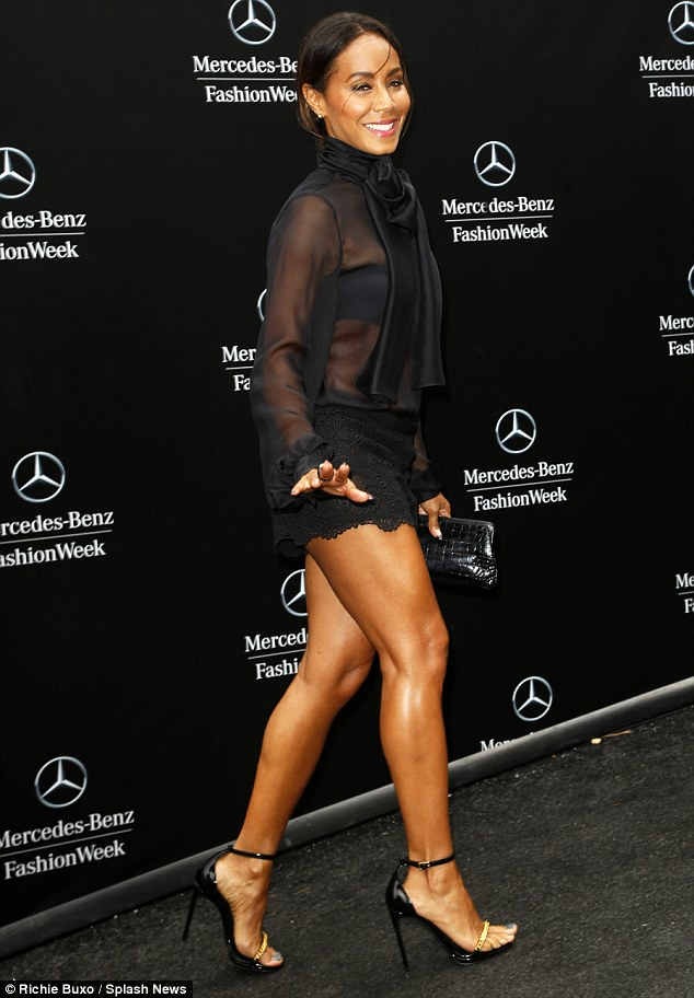 Jada- Pinkett -in - sheer top- and- lace- shorts -at -Dennis- Basso- show -for- NYFW