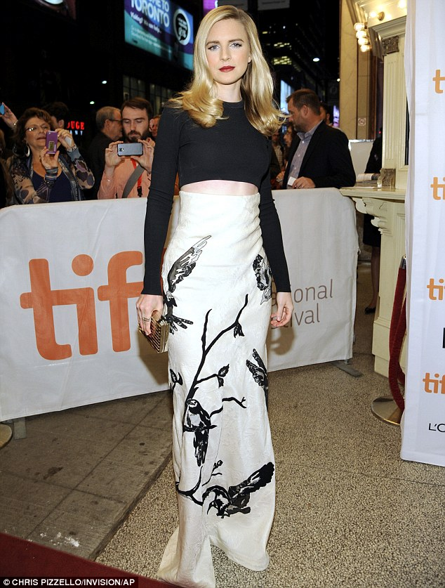 Actress Brit Marling, at the premiere of of The Keeping Room at Toronto International Film Festival in a cropped long-sleeved black blouse that bared her midriff and a long white skirt that featured a black avian print.