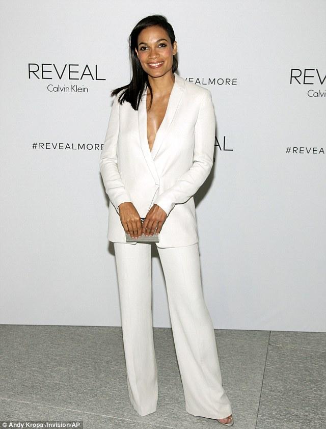 Rosario Dawson in a white Calvin Klein suit