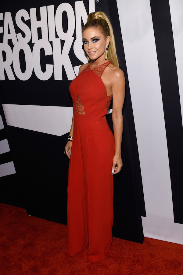 Carmen Electra in a red jumpsuit