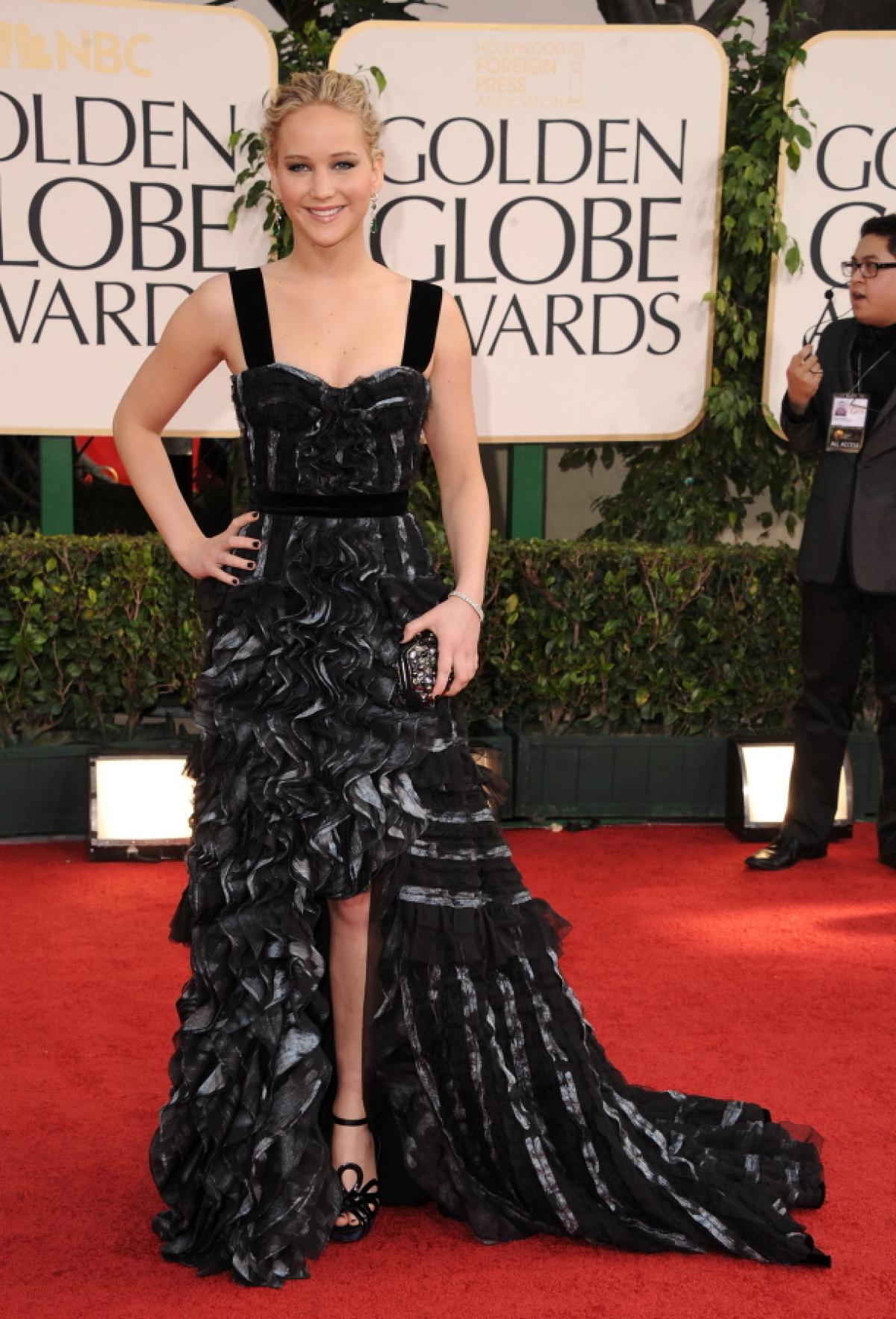 In a black ruffled Louis Vuitton gown at The Golden Globe Awards in L. A. on Jan 16, 2011
