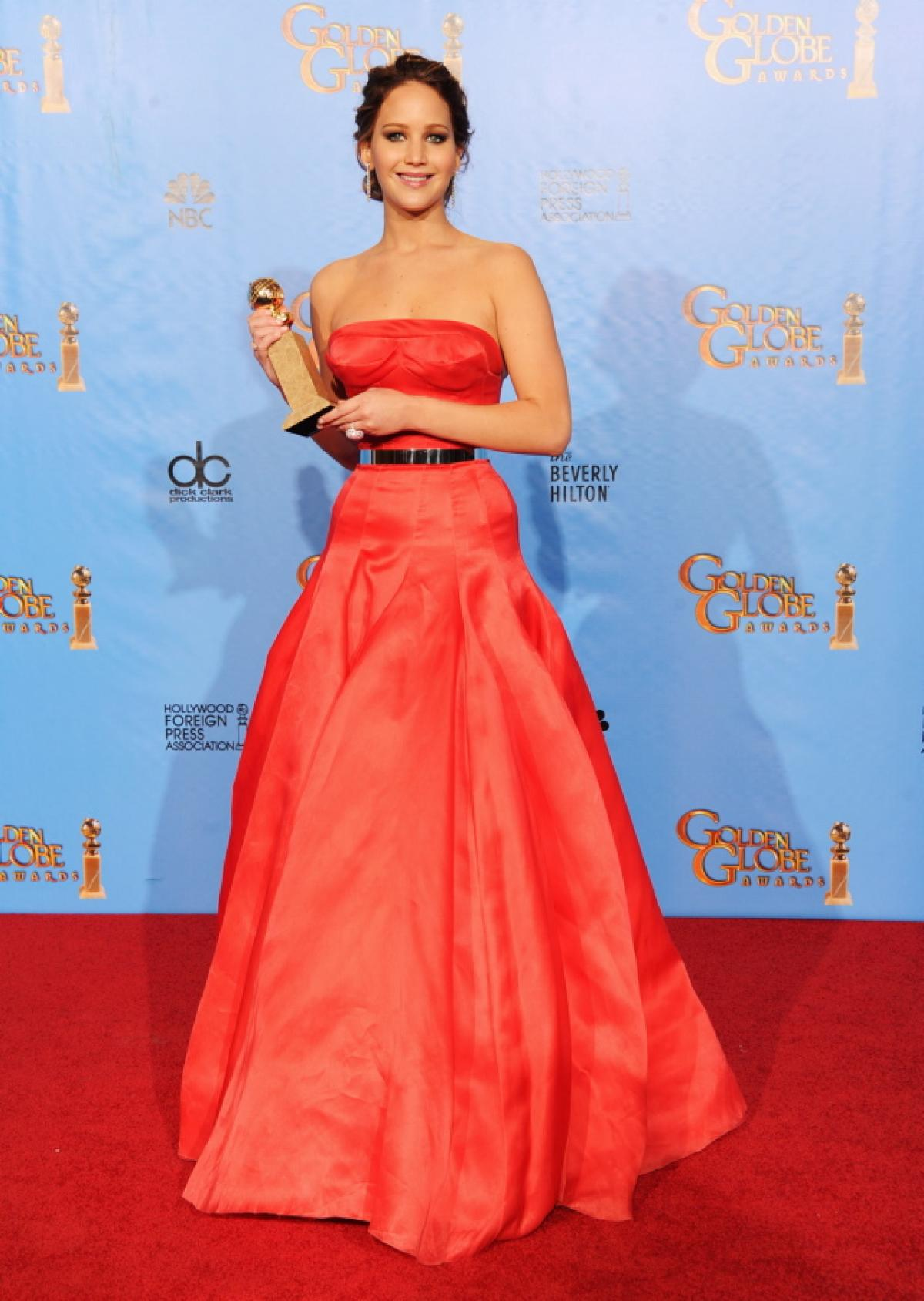 In a orange strapless Dior Couture gown at The Golden Globe A wards Jan 13,2013