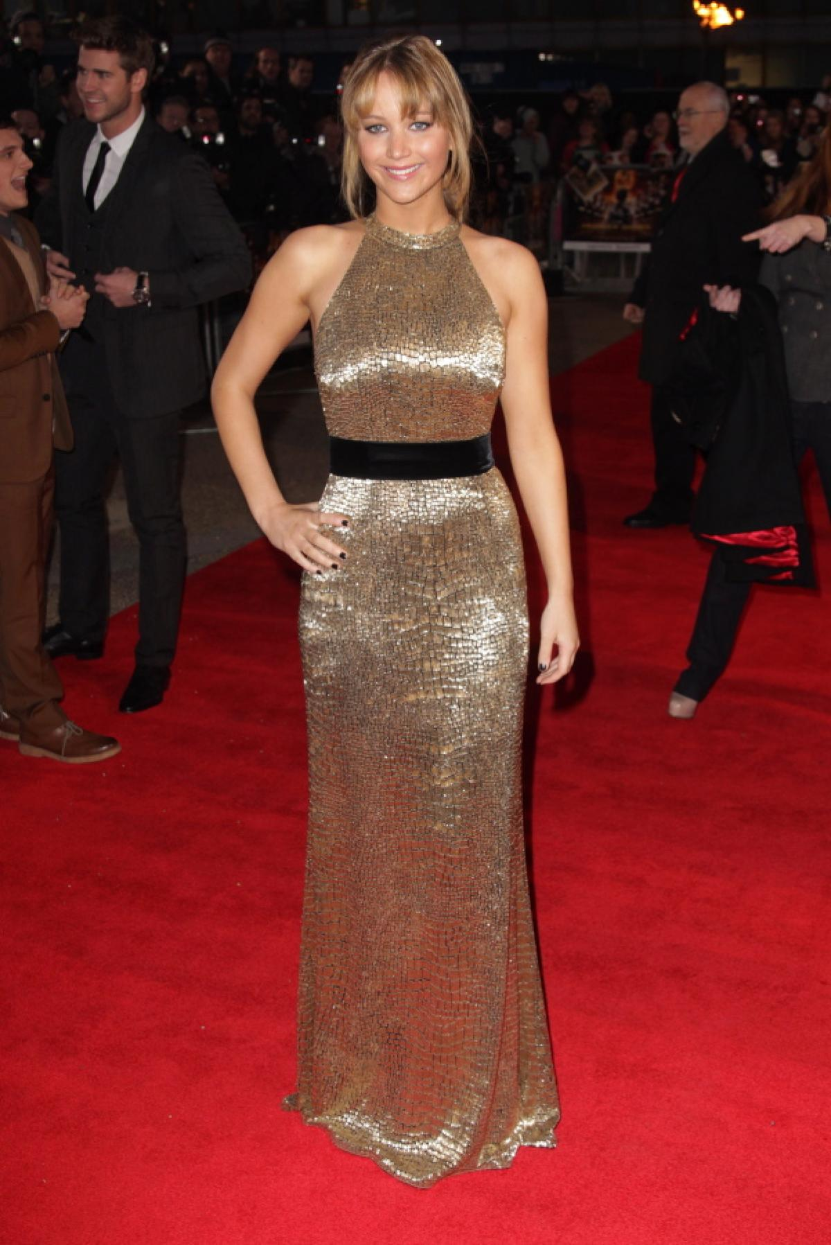 In a sequin strapless dress by Dior at The Screen Actors Guild Awards on Jan 18, 2014
