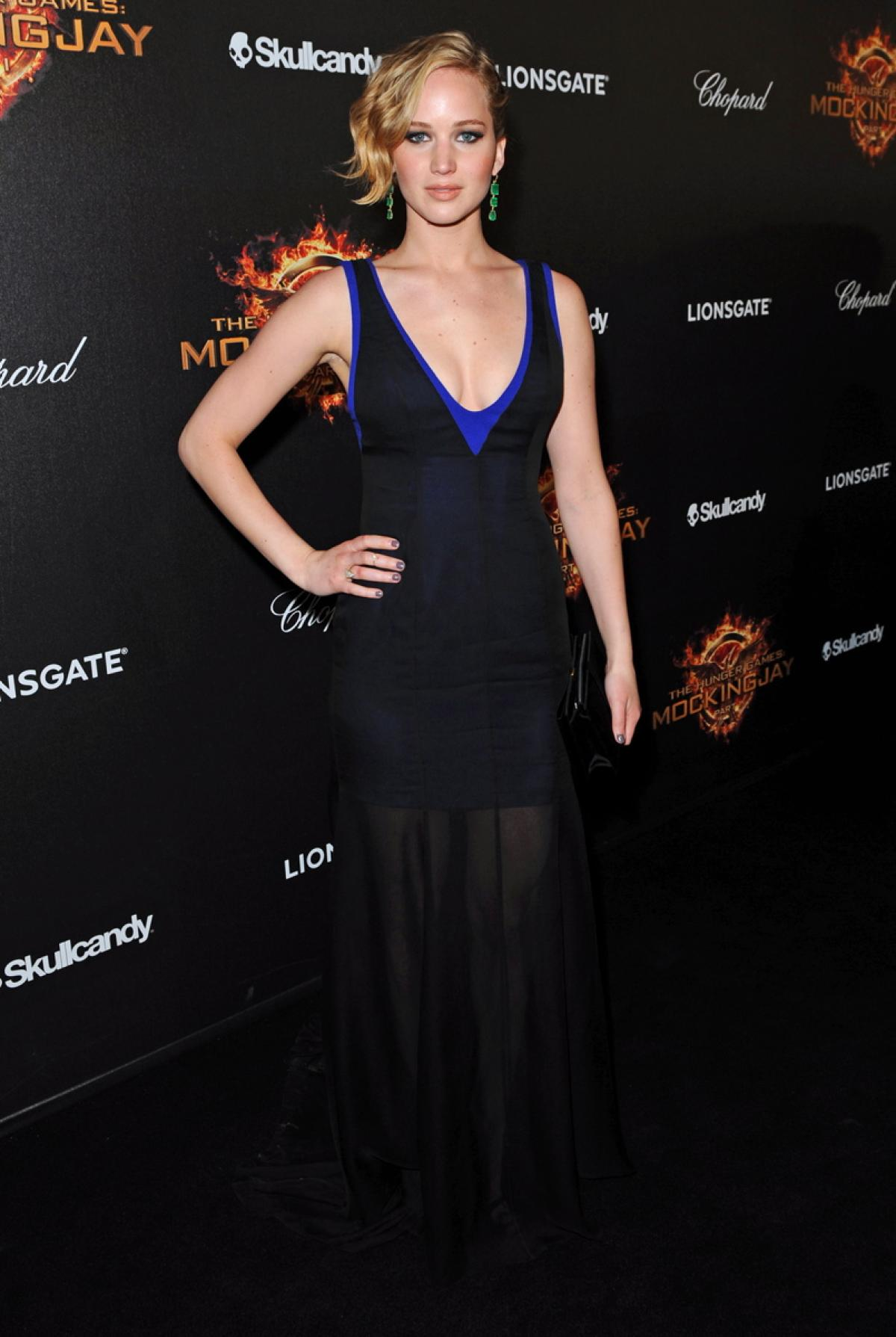In a V neckine black dress with blue details at The Hunger Games Mockingjay part 1 Premiere In Cannes France May 17, 2014