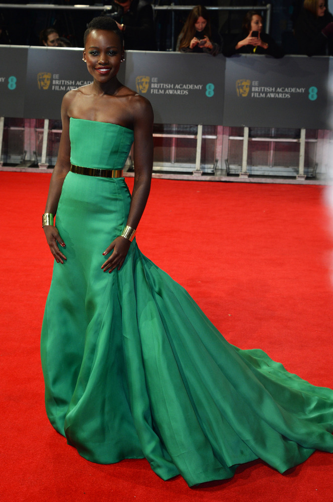 lupita nyongo in christian dior couture Lupita Nyongo attends the 2014 BAFTA awards at the Royal Opera House in London in a Christian Dior