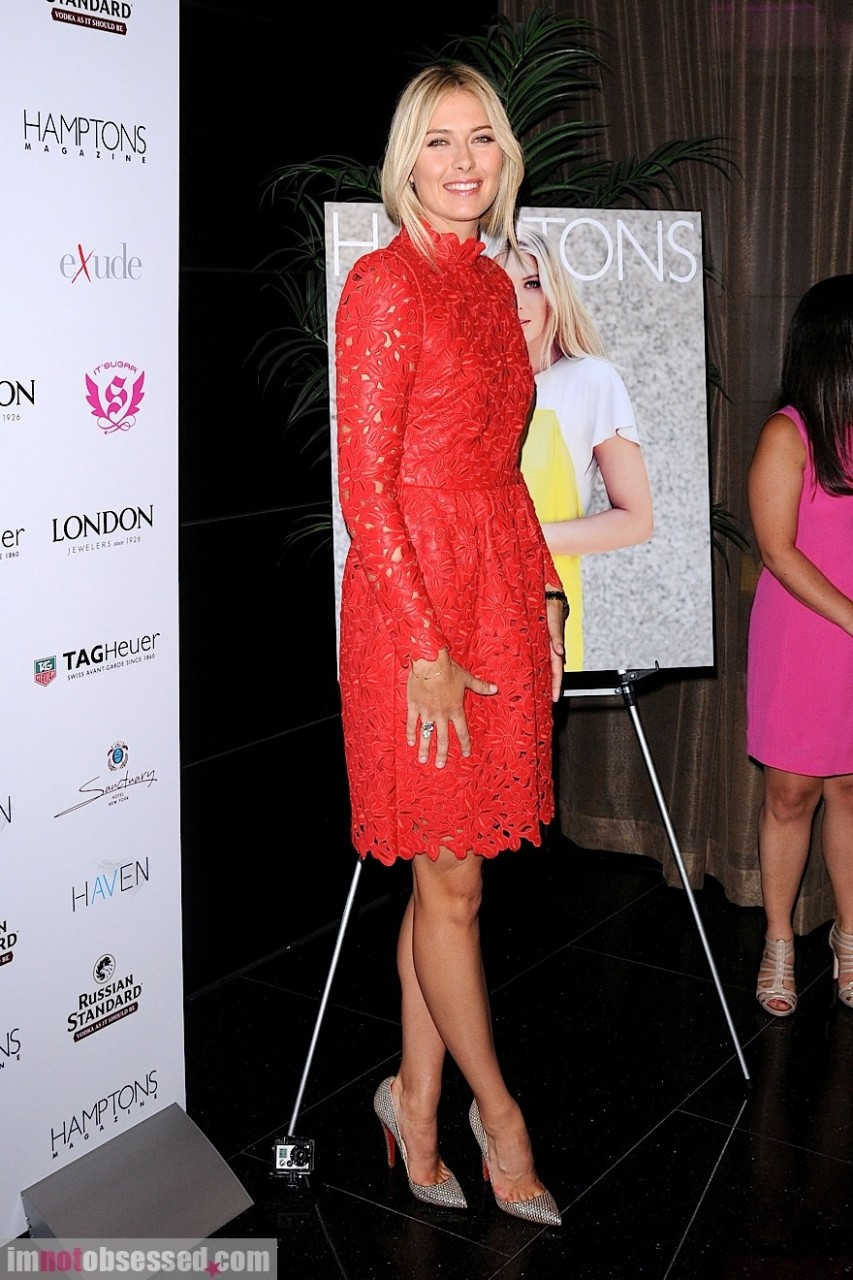 Maria Sharapova in a red Valentino dress at the Hamptons magazine cover party in New York City
