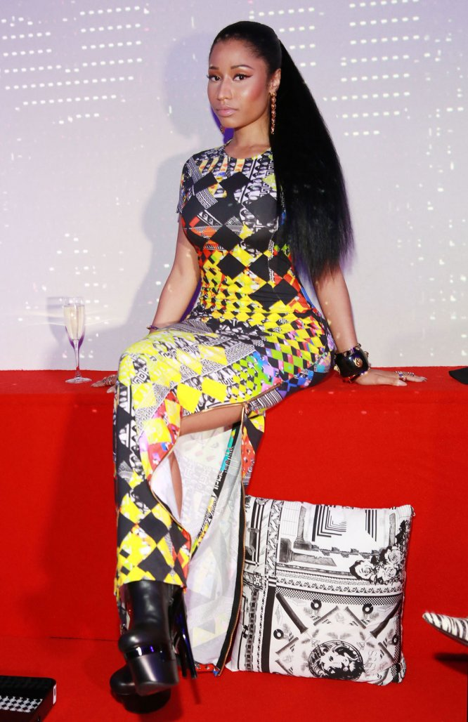 Nicki Minaj poses at the X Versus Versace after party on Sunday, Sept. 7, 2014, in New York. -