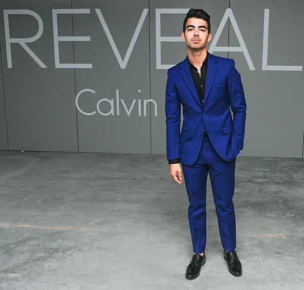 Joe Jonas in a Blue and black Calvin Klein suit