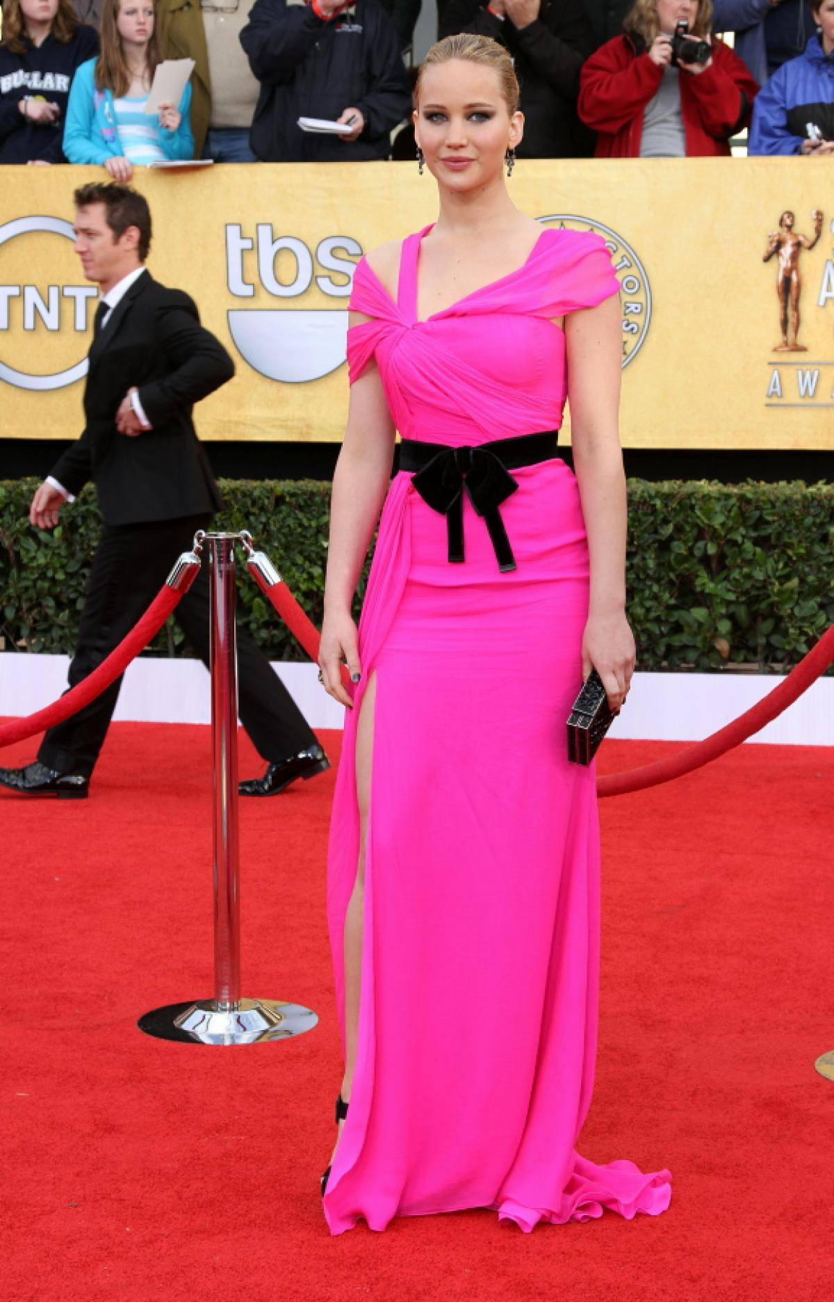 In a hot pink Oscar De La Renta gown with a black belt at The Screen Actors Guild Awards in L. A. Jan 30, 2011