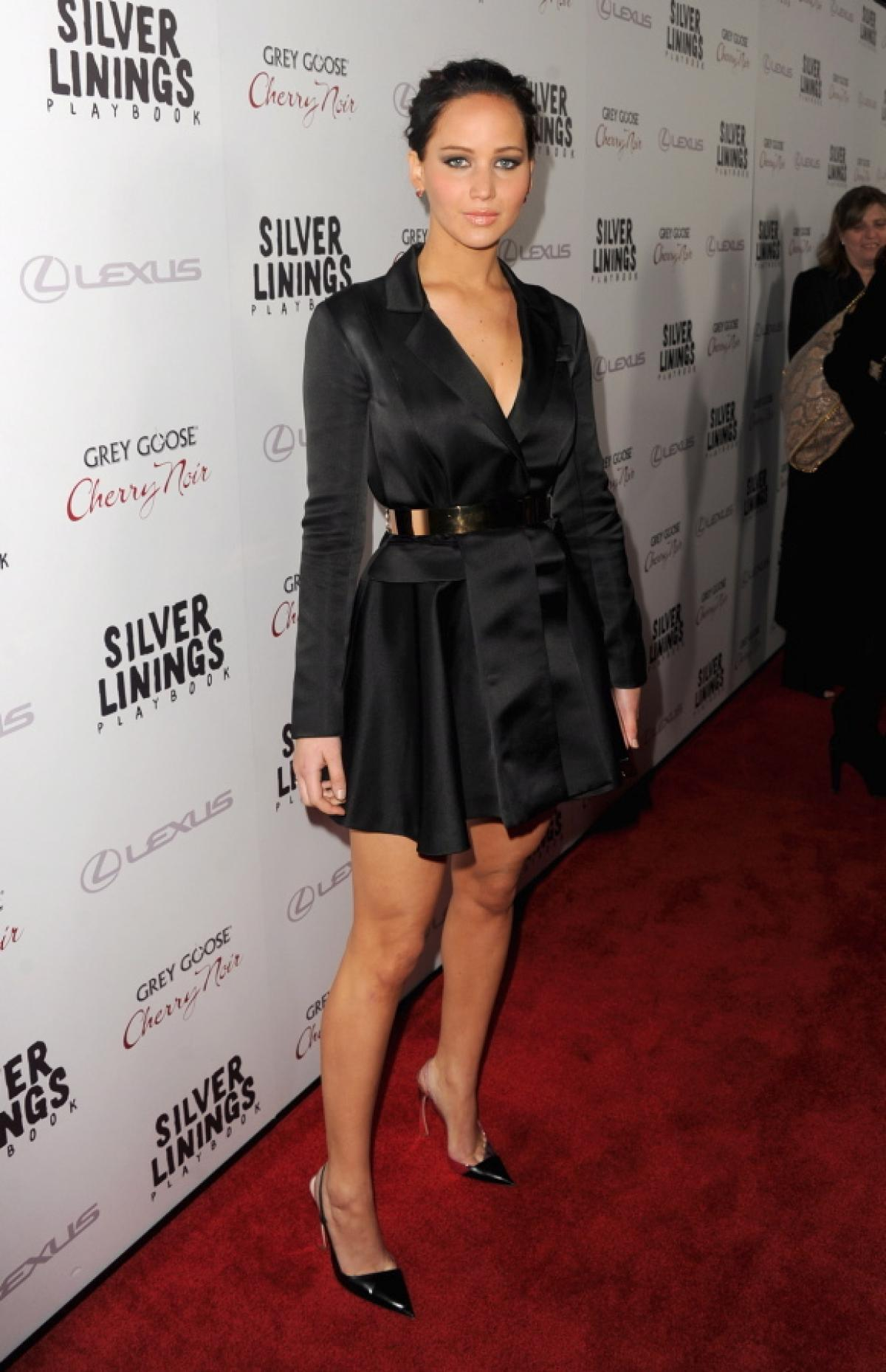 In a black satin Dior coat dress at Silver Linings playbook Screening Nov. 19, 2012