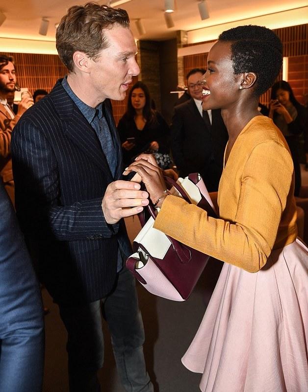 0-Lupita-Nyongo-Bally-Swiss-London-Store-Opening-Bally-Spring-2015-Orange-Top-Pink-Flared-Skirt-and-Burgundy-Coat