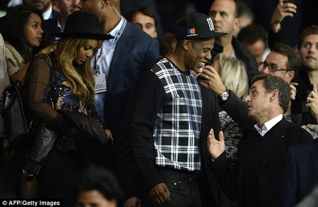 jay-z-wears-otr-tour-hat-and-alexander-mcqueen-check-front-sweatshirt-at-soccer-game-in-france/