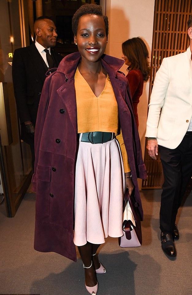 Lupita-Nyongos-Bally-Swiss-London-Store-Opening-Bally-Spring-2015-Orange-Top-Pink-Flared-Skirt-and-Burgundy-Coat