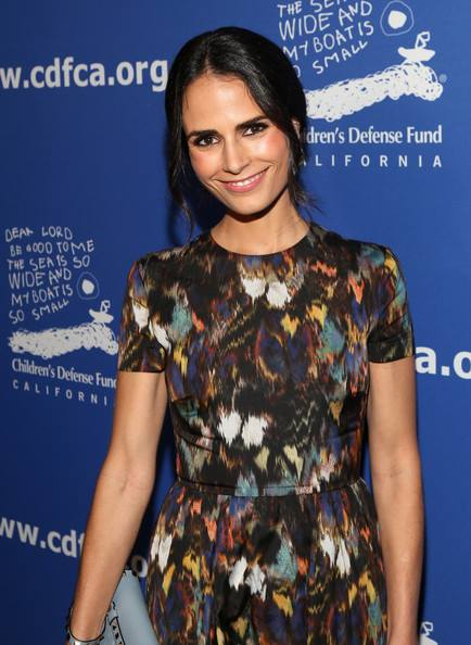 styled her look with a Valentino 'Rock Stud' clutch along with a pair of grey pumps . jordana-brewster-valentino-24th-annual-beat-odds-awards/