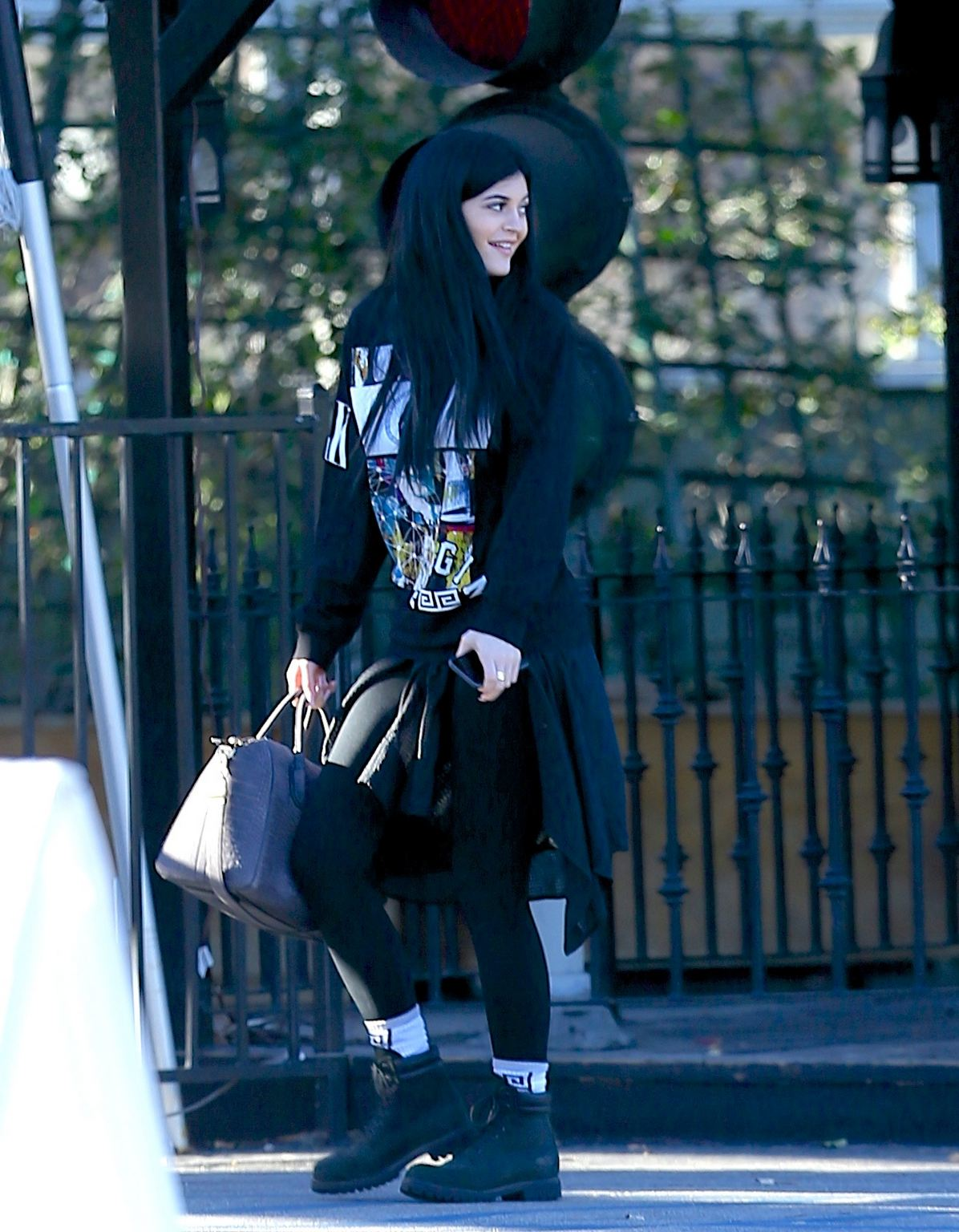 Kylie Jenner seen wearing Last Kings clothing while out to lunch with a friend on December 14, 2014.