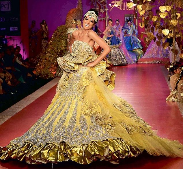 Model Jesse Randhawa presents a dress designed by Ritu Beri