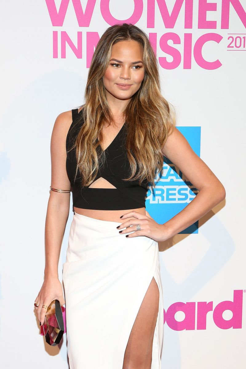 Chrissy -Teigen - wears- Yigal -Azrouel- at- the- 2014- Billboard -Women- in -Music- Luncheon.jpg