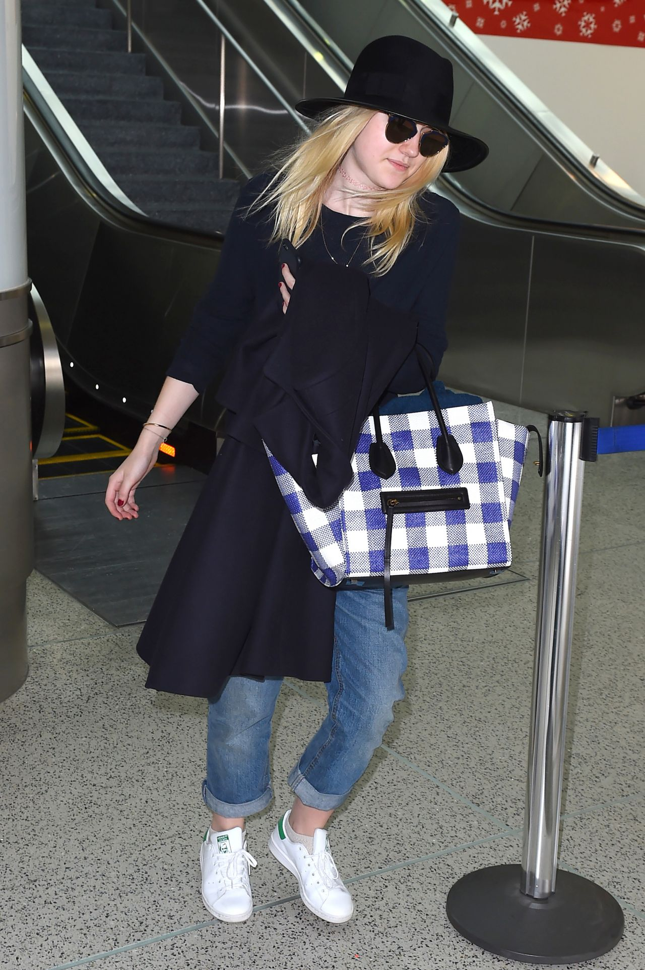 Dakota Fanning - LAX airport, December 2014 Dakota Fanning – LAX airport, December 2014