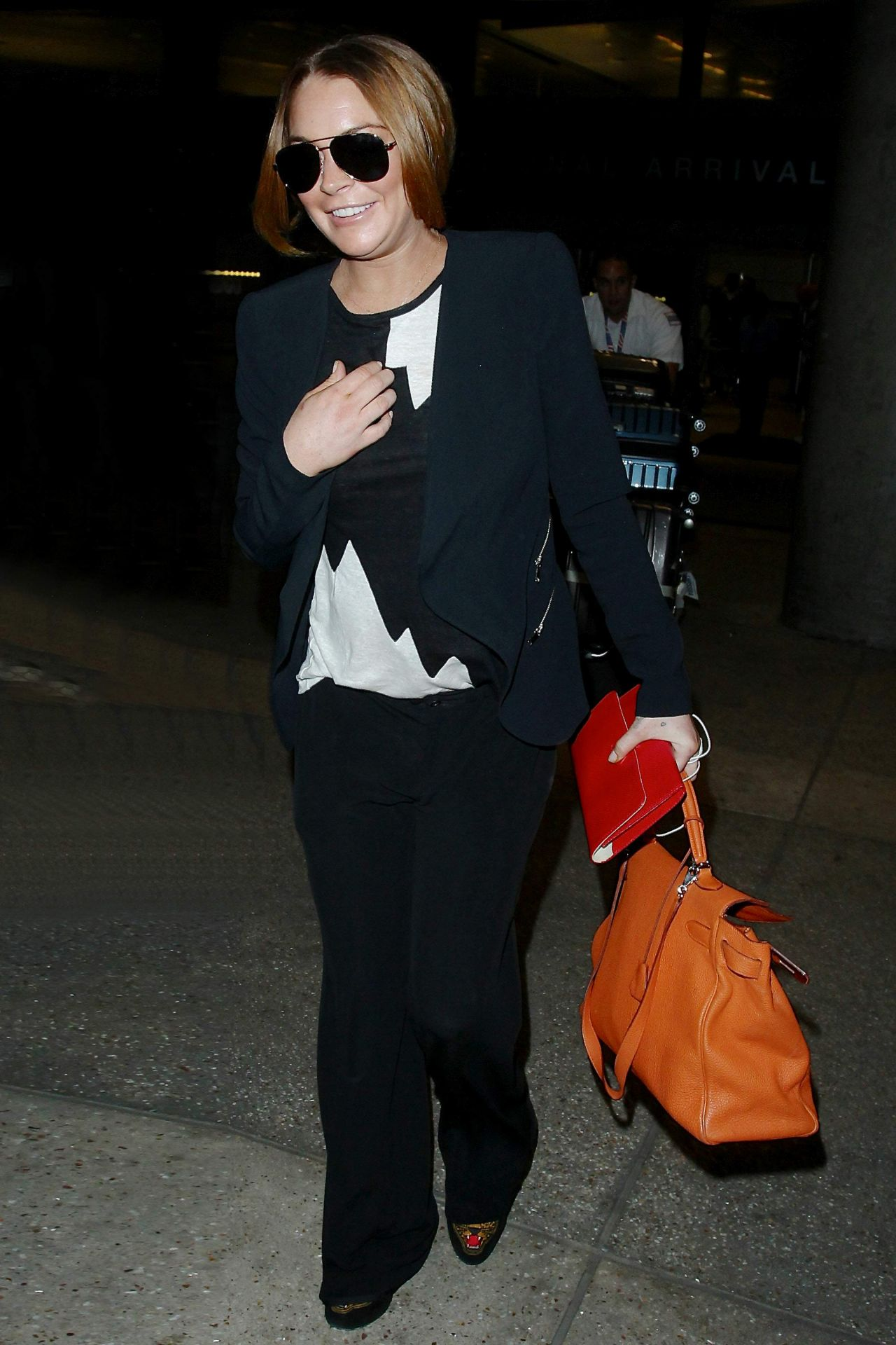 Lindsay Lohan Arriving on a flight at LAX Airport in Los Angeles – December 2014