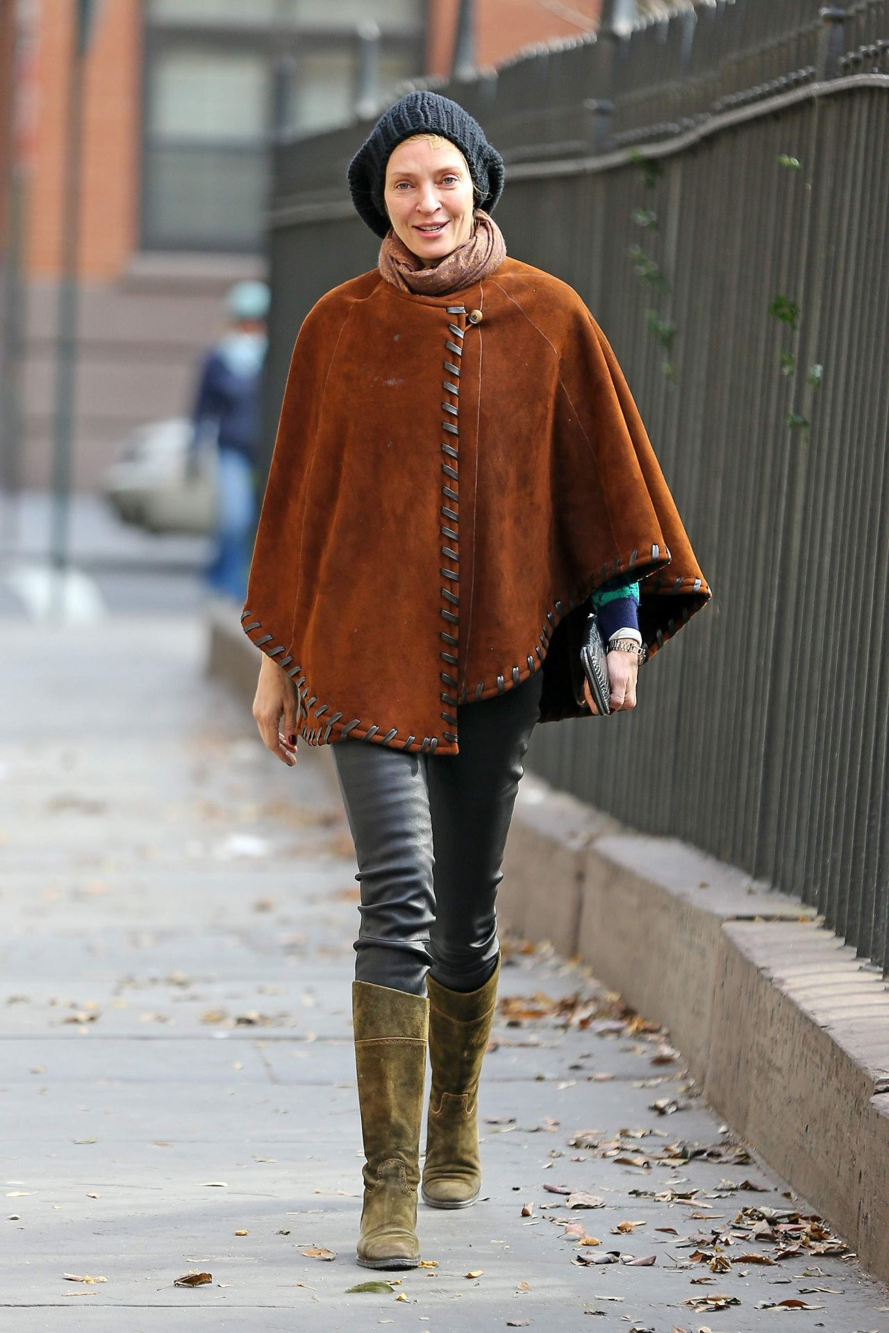 Uma Thurman in a Suede Poncho – Out in New York City – December 2014