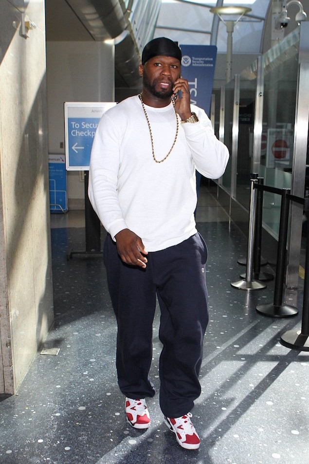 50Cent-wearing-Champion-Sweatpants-and-Air-Jordan-6-Retro-Carmine-Sneakers-Shoes-at-LAX