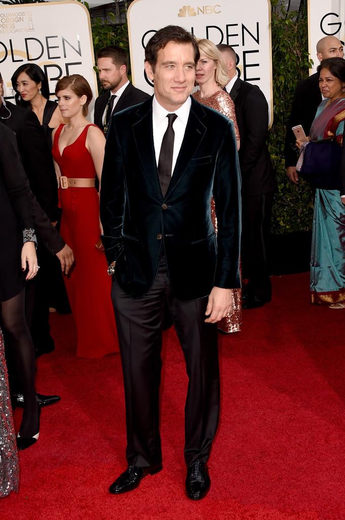 Clive Owen in an emerald green velvet Giorgio Armani suit