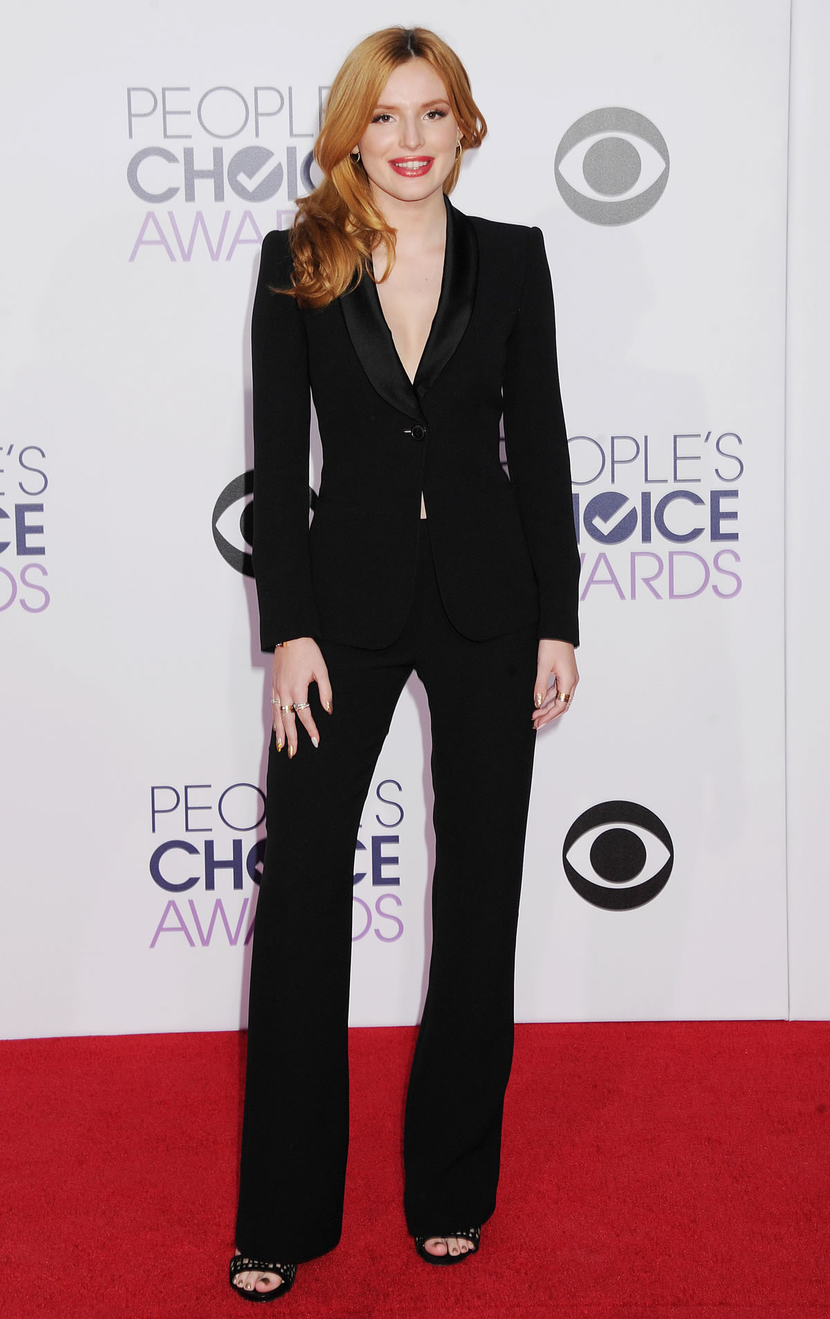 Bella Thorne in a Black Armani suit.