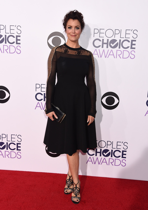 Bellamy Young in a black long -sleeved dress