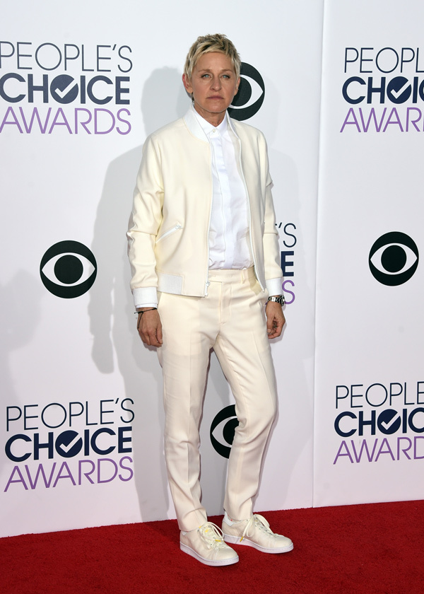 Ellen Degeneres in an ivory pantsuit styled with a white shirt.