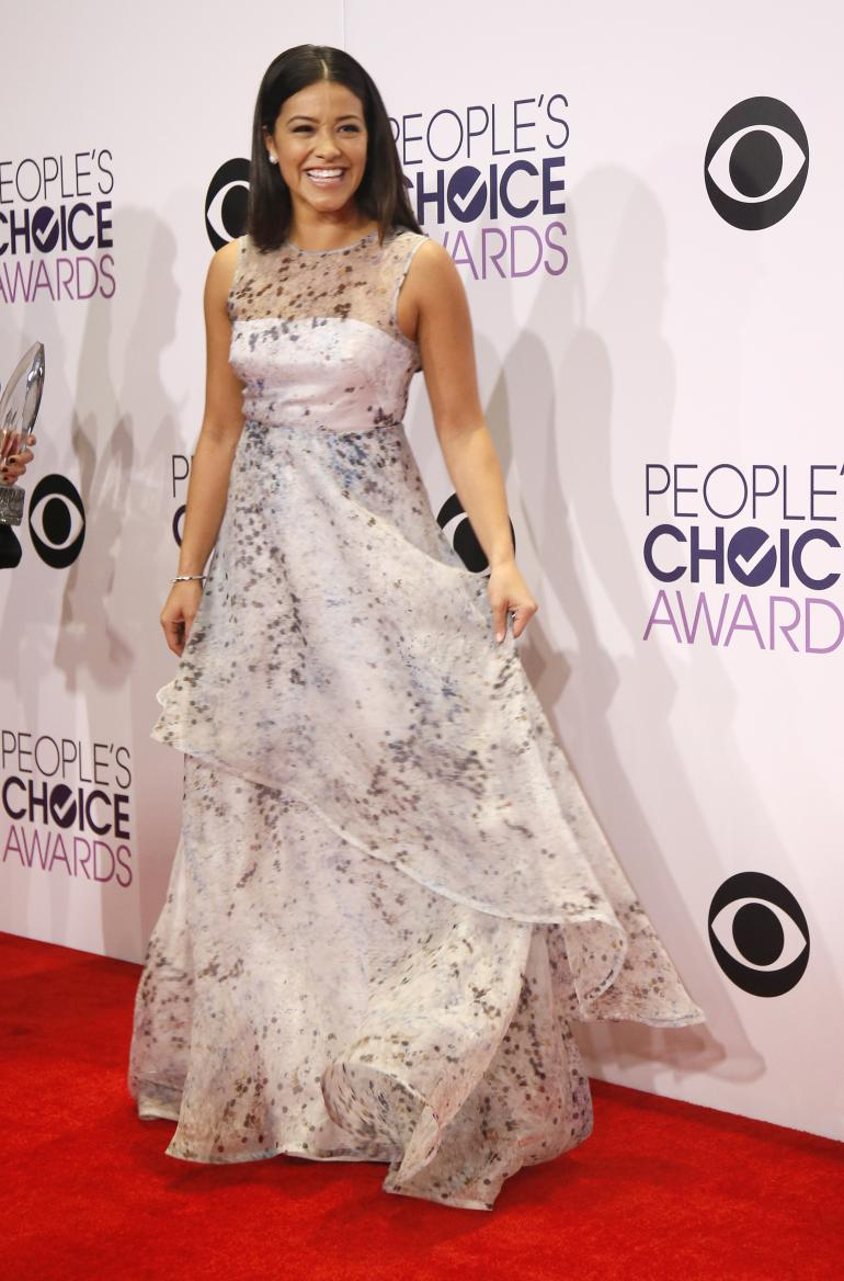 Gina Rodriguez in a sleeveless sheer panel print Nha Khanh Spring 2015 gown which she styed with Graziela Gems& Effy Jewels.