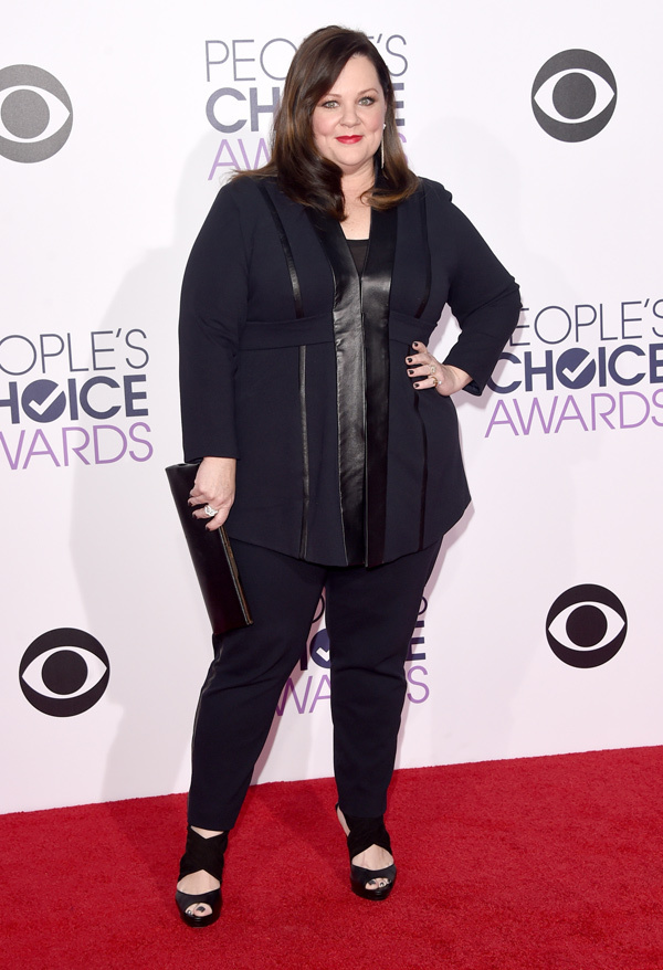 Melissa Mccarthy n a in black pants suit ensemble, styled with black pumps and minimal gold jewelry
