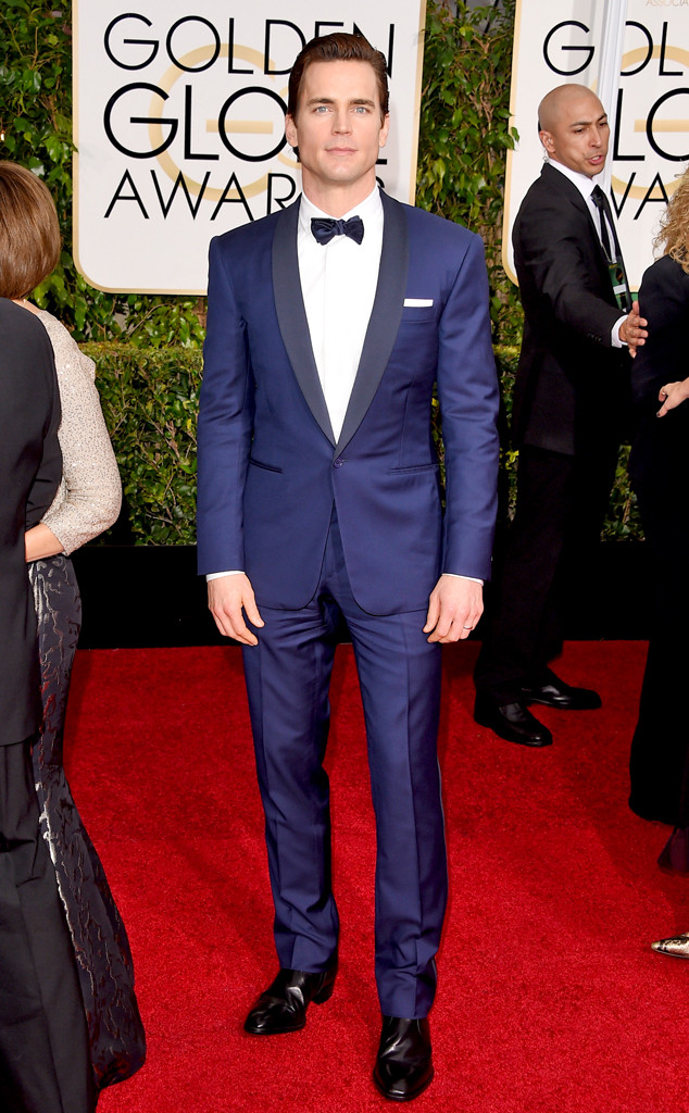 Matt Bomer in a blue suit paired with a white shirt and black bow tie