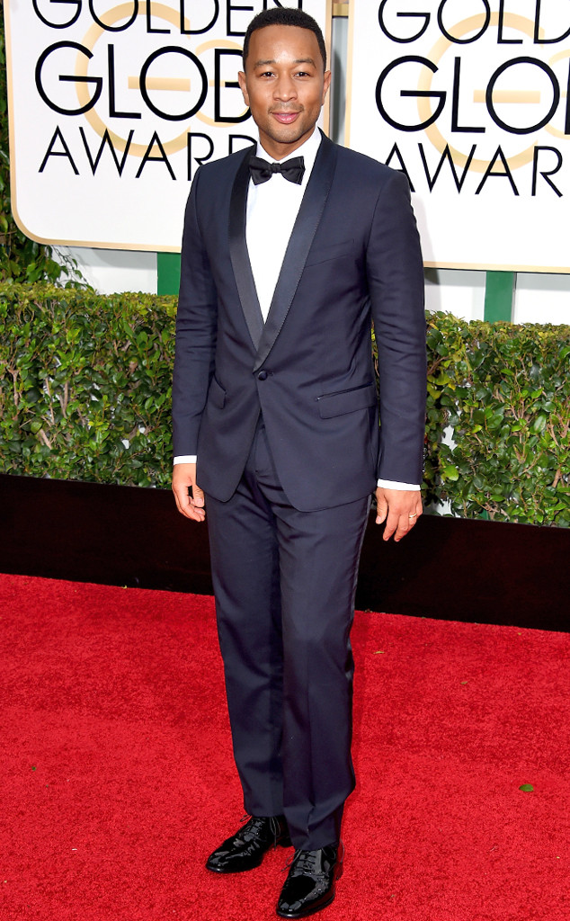 John Legend in a navy blue suite paired with a white shirt and black bow tie